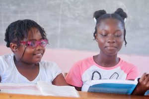 Girls learning with books